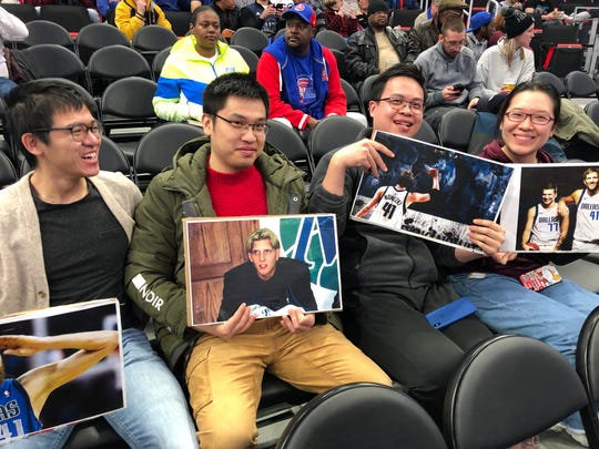 Dirk Nowitzki fans display their pictures of the German forward before the Pistons game on Thursday.