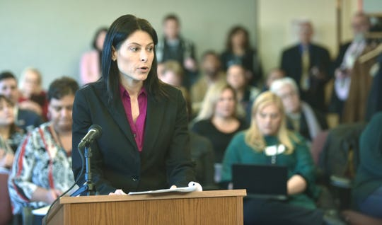 Michigan Attorney General Dana Nessel addresses Michigan Civil Rights commissioners Friday at Cadillac Place in Detroit.