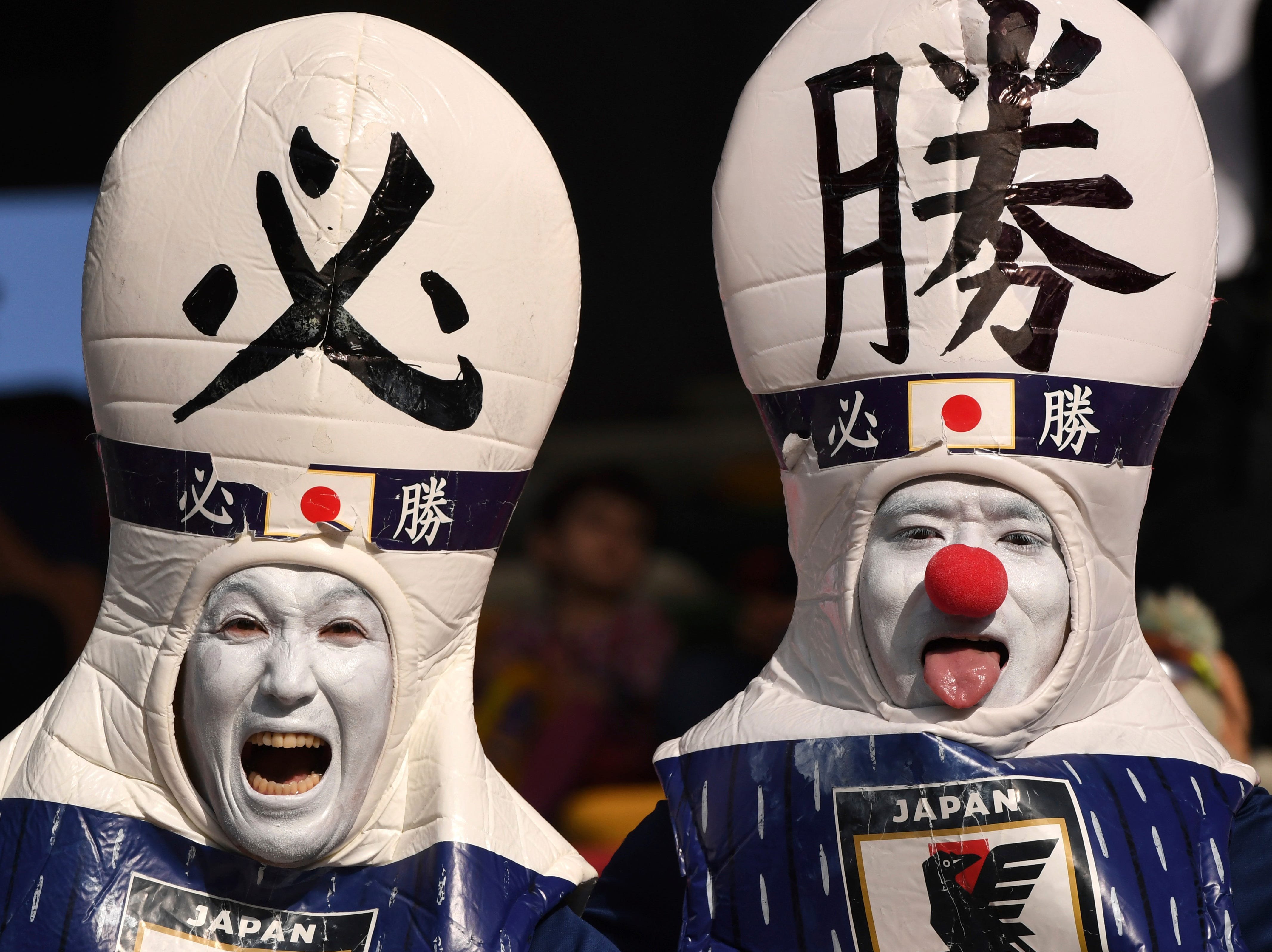 Fans of Japan make grimaces prior the start of the AFC Asian Cup final match between Japan and Qatar in Zayed Sport City in Abu Dhabi, United Arab Emirates, Friday, Feb. 1, 2019.