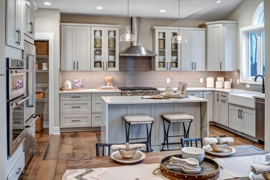 Kitchen islands rank as one of the top requested must-haves with new home buyers.