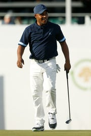 Harold Varner III reacts after making his putt attempt on the 16th green.