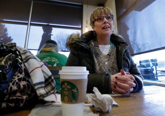 In this Tuesday, Jan. 29, 2019, photo Laurie Ware, a customer at Starbucks in Nashua, N.H., speaks about a potential presidential run by Starbucks founder Howard Schultz.