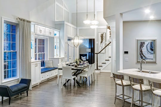 Low-maintenance villas and townhomes like this Villa pictured at Toll Brothers' Kensington Woods community in Ann Arbor offer open designs and an easy lifestyle.