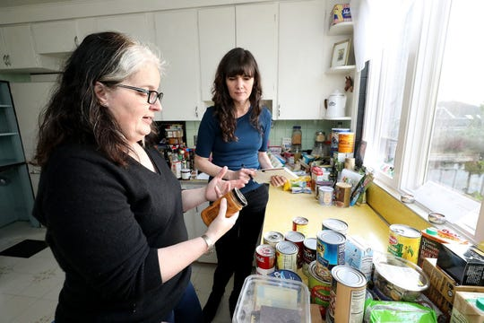 Food waste expert Jill Lightner, left, discusses what to keep and what to throw away with Bethany, center.