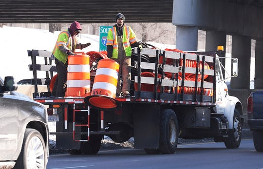 M-Dot workers put barriers on the left southbound lane of I-75 just south of 7 mile road., February 1, 2019 in Detroit, Michigan.