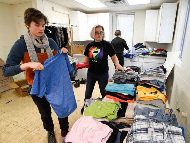 Evansville's Signature School students, left to right, Nick Johnson, Jordan Huck and Emme Lang work to put together a LGBTQ+ clothing bank at the St. Paul's Episcopal Church Begley Annex Thursday. Set to open on Saturday, the Rainbow Jacket Project will provide a place for trans and queer kids to feel like they belong, January 31, 2019.