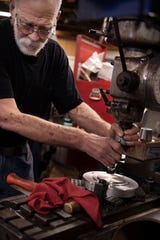 Keith Benedict, owner of BigFoot Technical Services on the West Side of Evansville, works on a milling machine to create an airplane part for a customer Monday afternoon.