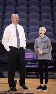 Matthew Graves, an assistant coach with the University of Evansville men's basketball team, finds time to visit with his daughter, Lillian, 11, before the Purple Aces' game against Bradley at the Ford Center Wednesday night