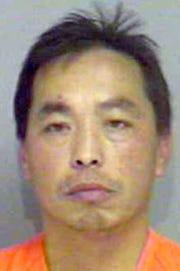This booking photo provided by the Sawyer County, Wisconsin's Sheriff's Department shows Chai Vang on Sunday, Nov. 21, 2004, at the Sawyer County Sheriff's Department in Hayward, Wis. A dispute among deer hunters over a tree stand in northwestern Wisconsin erupted Sunday in a series of shootings that left five people dead and three injured, officials said. The alleged gunman was arrested at about 5:15 p.m. Sunday at the Rusk and Sawyer County line, according to Sawyer County sheriff's officials. Jake Hodgkinson, a deputy at the county jail, identified the suspect as Vang but would give no additional details. Several news organizations in Minneapolis-St. Paul reported the suspect was 36-years-old and from St. Paul.