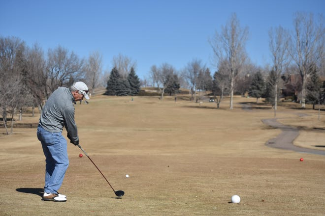 Steve Sivon of Fort Collins tees off on the No. 1 hole at Southridge Golf Course in Fort Collins on Friday. Some courses are closing because of the unusually dry winter.