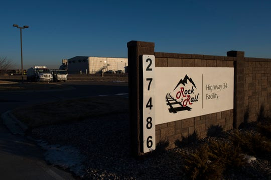Recently installed signage for the Rock & Rail LLC concrete distribution center, once owned and operated by Martin Marietta Materials, is visible from the west side of the facility on Weld County Road 13 south of U.S. Highway 34.