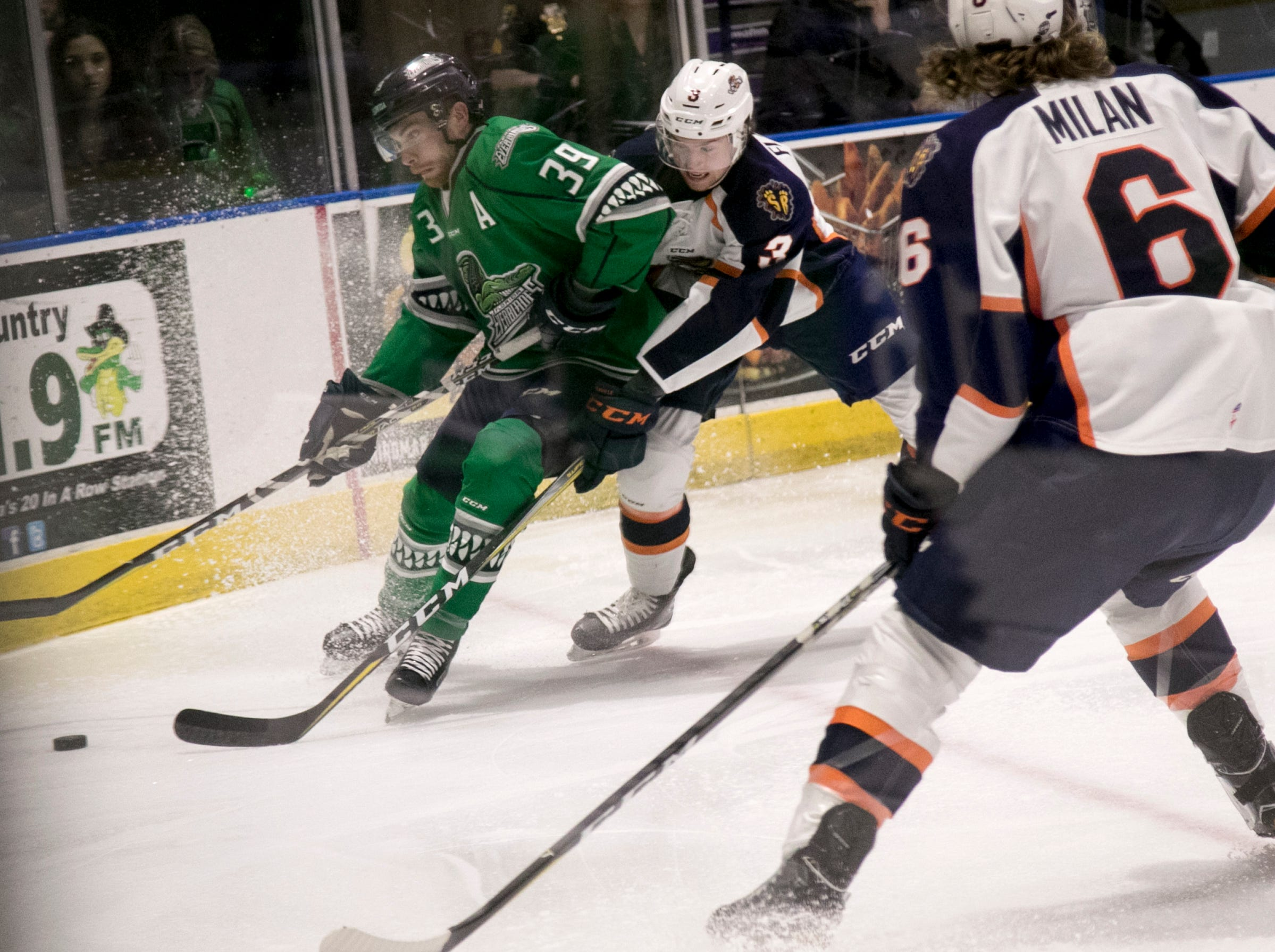Joe Cox of the Everblades holds off Sean Flanagan of Greenville in the first period on Friday night, January 11, 2019, at Hertz Arena in Estero.