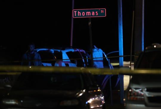 Fort Myers Police Department officers work the scene of a shooting on Thursday at the intersection of Thomas Street and Henderson Avenue near Franklin Park Elementary School in Fort Myers. Witnesses said at least two people were shot and later transported by ambulance to an area hospital. FMPD is still investigating and have not released any additional information.