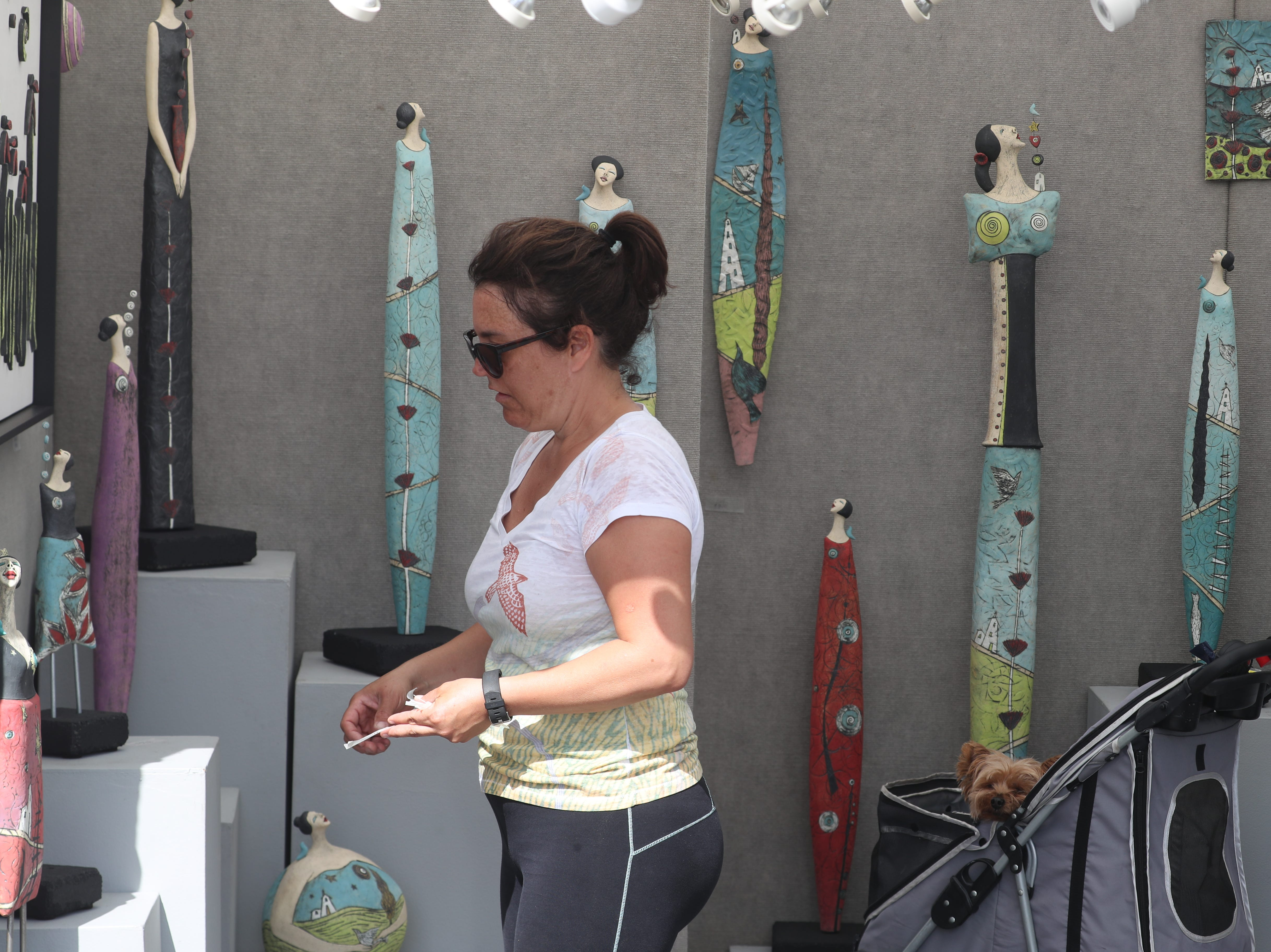 Artists spent the morning setting up for ArtFest Fort Myers downtown on Edwards Drive. The festival goes all weekend.