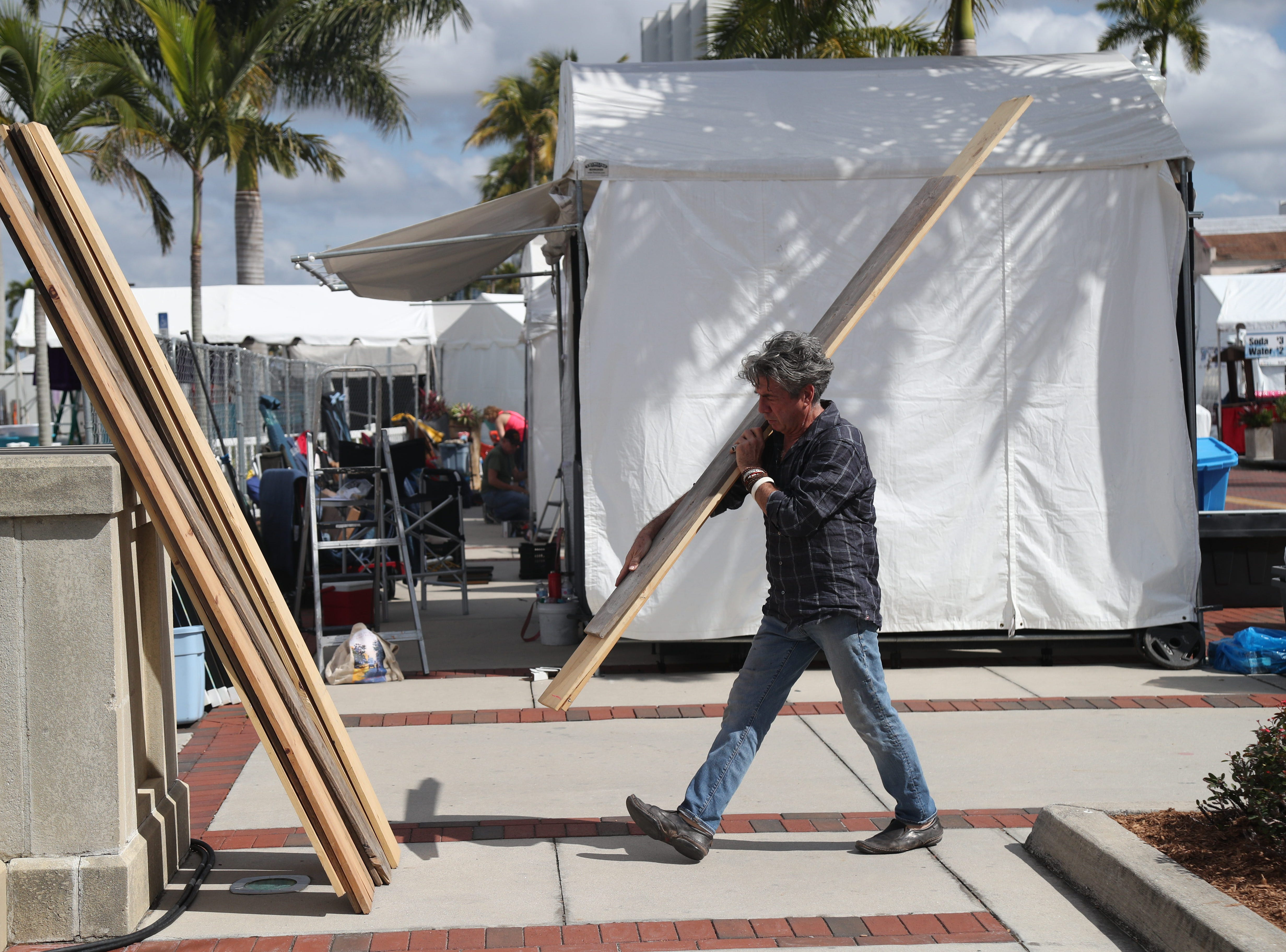 Jack Charney, a ceramic sculptor and potter from New Mexico, sets up at ArtFest in downtown Fort Myers on Friday, Feb 1, 2019.