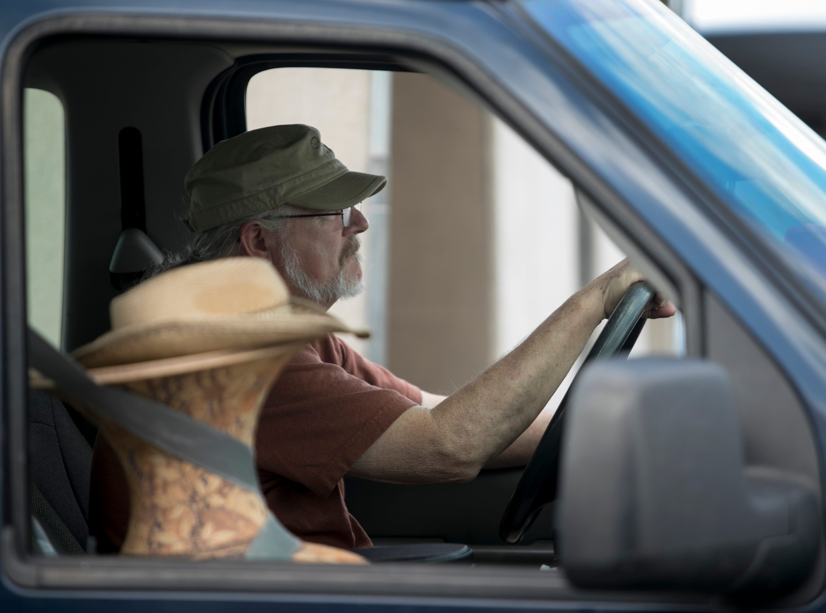 Don McWorter of Carrolton, Ga., pulls into ArtFest with one of his pottery pieces riding shotgun on Friday, Feb 1, 2019, in downtown Fort Myers. Artists were busy setting up Friday morning to prepare for the Opening Night event Friday night and the festival on Saturday and Sunday.