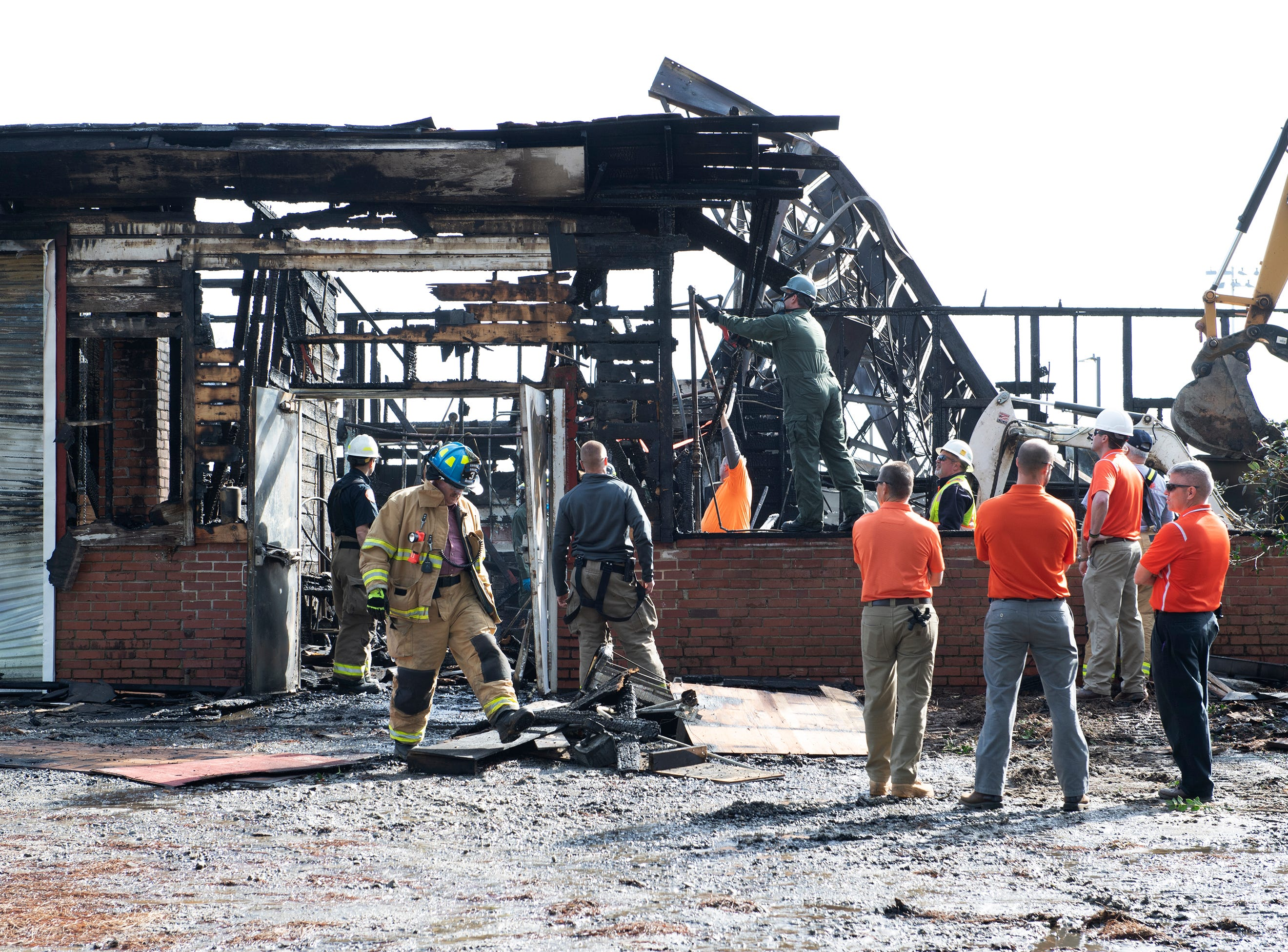 Emergency and Clemson personnel work on Clemson's Y Barn which burned down Friday, February 1, 2019.