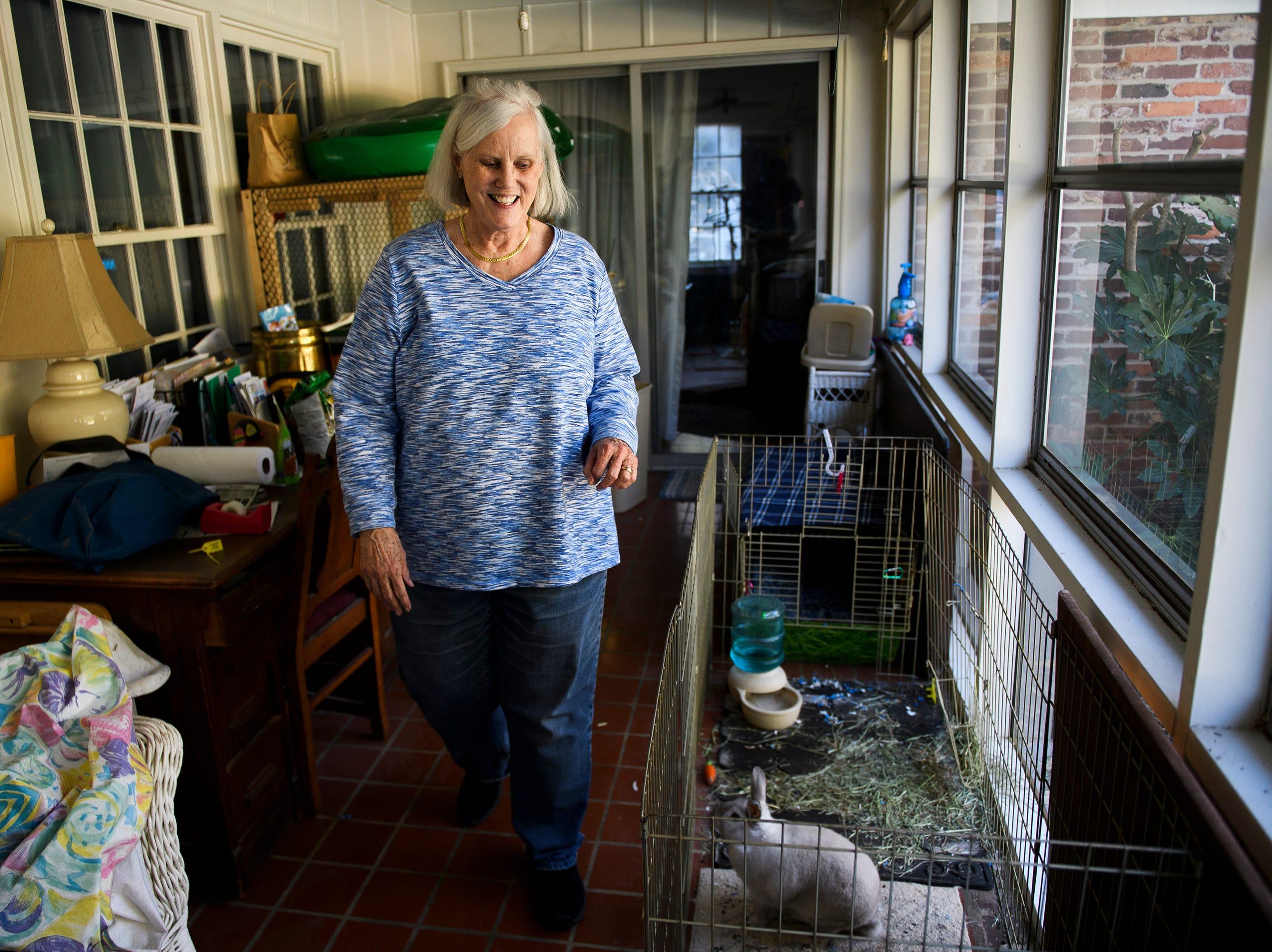 Lovick Richardson walks past her rabbit Bun Bun in her home on Feb. 1, 2019.