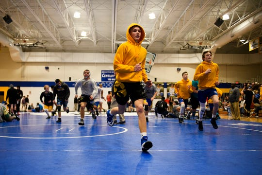 Eastside players warmup before competing in the Region 2-AAAA wrestling championship at Eastside High School on Thursday, Jan. 31, 2019.