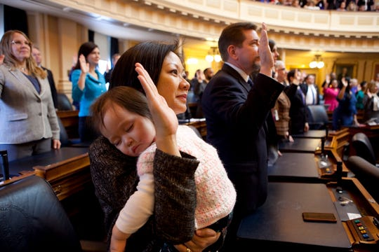 Virginia Del. Kathy Tran, D-Fairfax, holds her daughter Elise during her swearing-in ceremony at the Virginia General Assembly in 2018. MUST CREDIT: Photo by for The Washington Post by Timothy C. Wright.