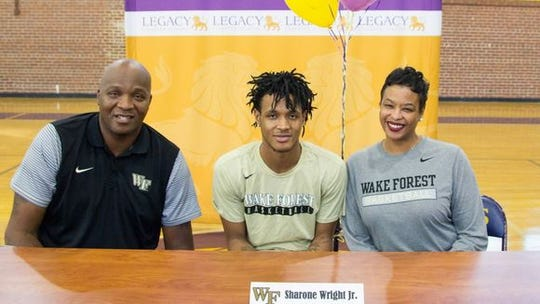 Sharone Wright Jr., flanked by his father and mother, announces that he'll play college basketball at Wake Forest.