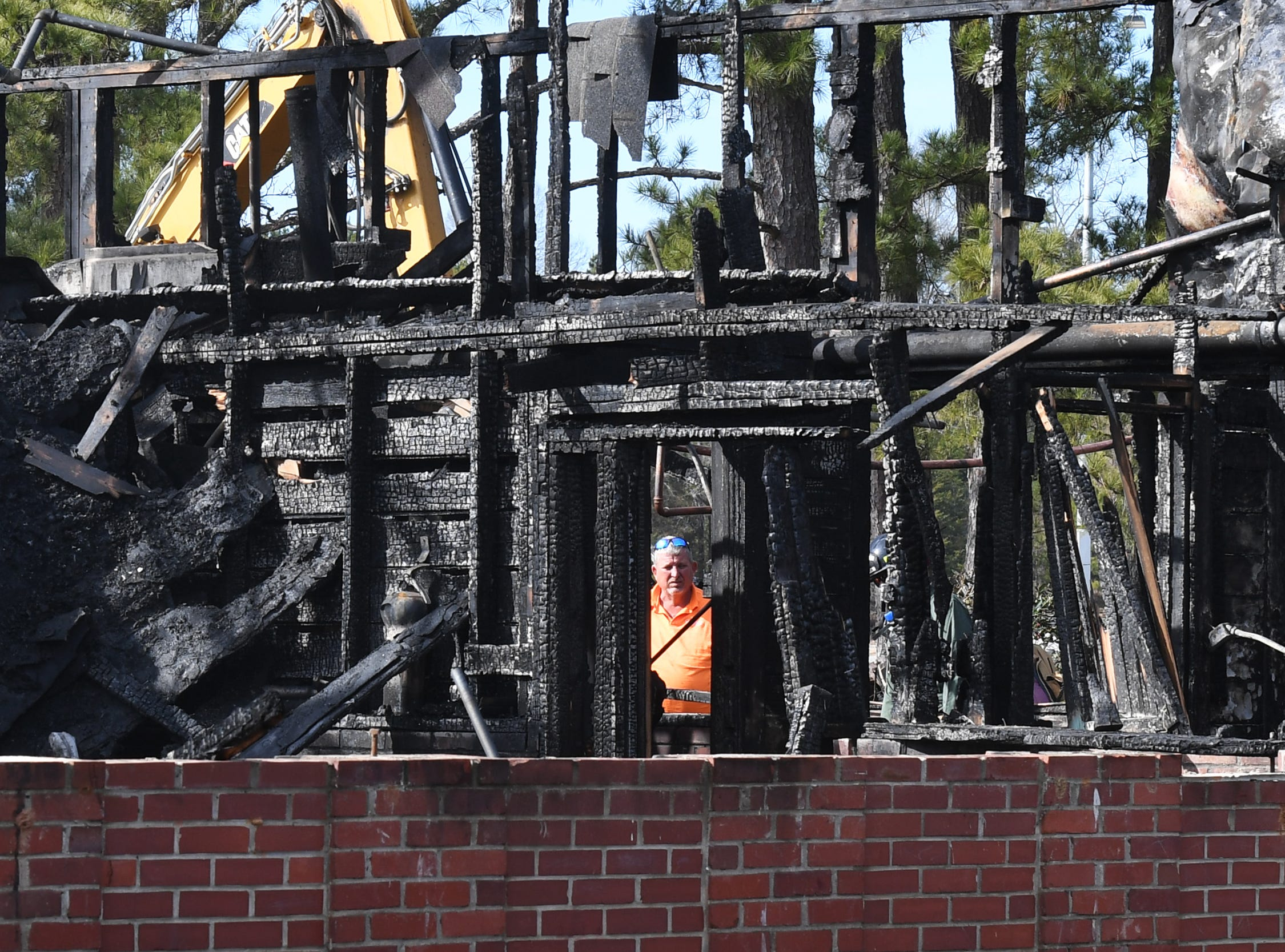 Jay Whitmire from Clemson University's Utility Services works on a building that burned on campus Friday, Feb. 1, 2019.