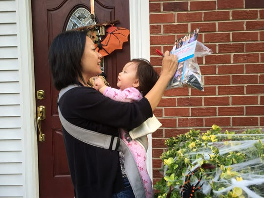 Then-candidate Kathy Tran takes her baby Elise with her on the campaign trail in Springfield, Virginia, in October 2017. MUST CREDIT: Washington Post photo by Michael Chandler.