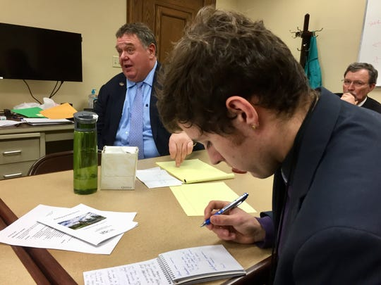 Tim Pierce, University of Montana journalism student, takes notes during a recent meeting with Republican legislators.