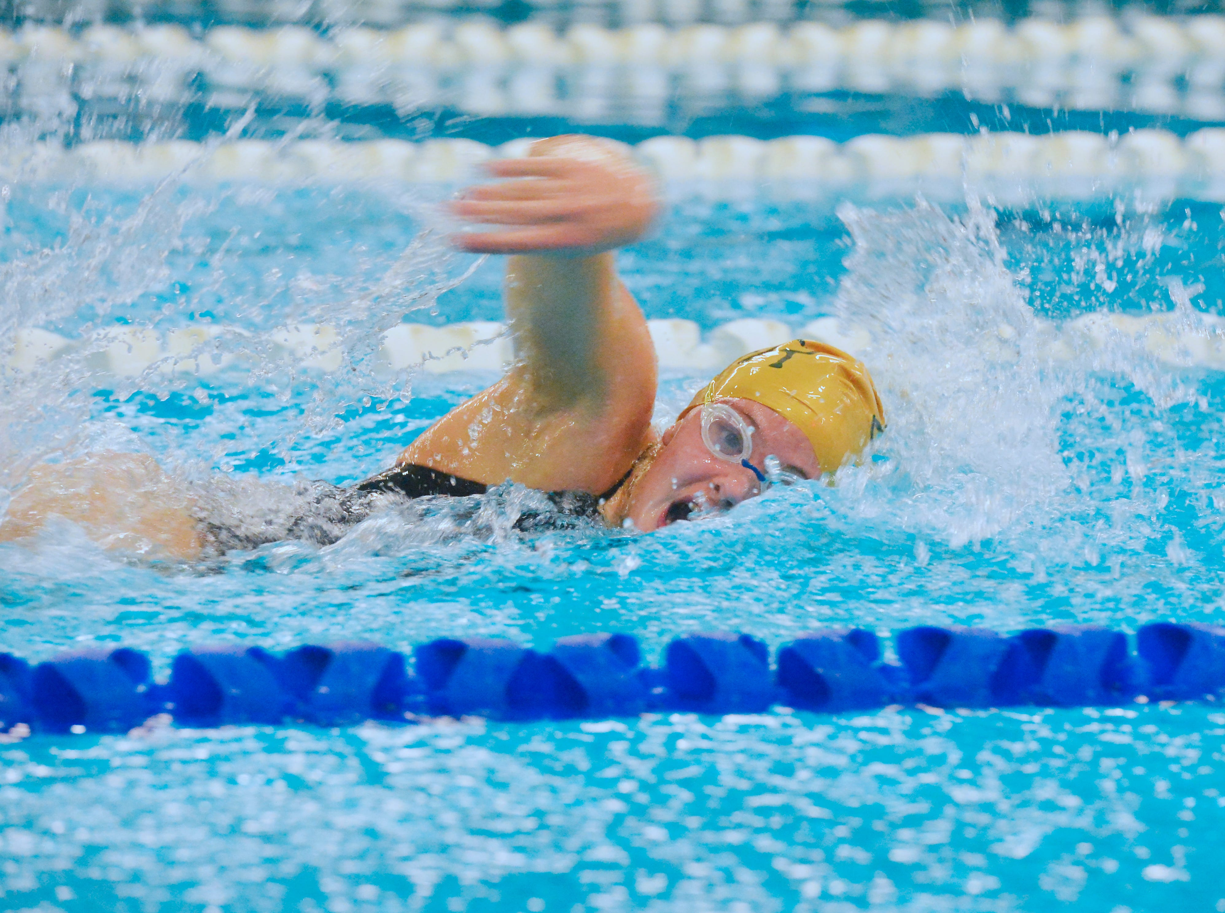 CMR's Lizzy Jaraczeski swims the 100 yard freestyle during the crosstown swim meet at Great Falls High, Thursday evening.