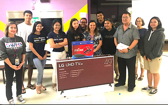 "The George Washington High School Parent-Teacher-Student Association donated a 49"" TV and a PS4 game console on Dec. 18 during the December meeting. This donation is to support the school's game room which serves as an incentive for students with good attendance and behavior. Pictured from left: Lynda Hernandez-Avilla, GW principal, Collin Borja, Christiana Ebio, Trisha Canlas, SBA President, Sara Dela Rosa, Denzyl Ngiralmau, Marlene Quintanilla, GW curriculum/JHTD coordinator, Jacob Sablan, Joreen Cruz, junior class president, George-Anthony Borja, PTSA president, Joann Blas, PTSA secretary, and Josephine Fathal, NHS president."