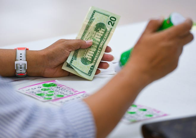 A player marks her cards in hopes of winning a payout prize during an early-bird mini bingo game at the Plumeria Bingo hall in Tamuning in this Feb. 1 file photo.