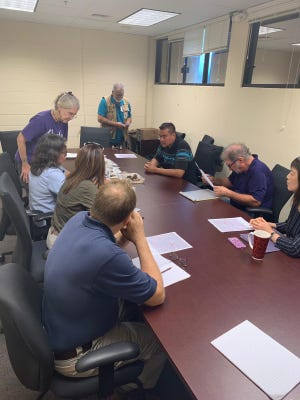 Representatives of Marine Corps Activity Guam and the Guam State Historic Preservation Office meet Jan. 28 to discuss artifacts found a week earlier at the construction site of the new Marine base in Dededo.