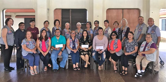 The Guam Sunshine Lions Club provided financial assistance to help with medical expenses on Jan. 12 to the following: Daniella Tenorio-Balbas, 29; Ja-Ana Marie T. Duenas, 20; and Maina Haani Pocaigue, 10.  Seated from left: L. Julie Cruz, L.Tish Tano, Frankie Nededog (accepted donation on behalf of daughter Maina Haani Pocaigue), L. Jill Pangelinan, Daniella Tenorio-Balbas, Jaime Duenas (accepted donation on behalf of Ja-Ana Marie T. Duenas), L. Connie Rivera, P.L. Marie Salas, and L. Loling Blaz.  Standing from left: L. Doris Limtiaco, Ed Pocaigue, D'Shaun Pocaigue, L. Dee Cruz, L. Sera Taitano, L. Helen Colby, L. Jovie Mejorada, L. Dot Leon Guerrero, L. Josephine Borja, L. Marietta Camacho, L. Sid Weedin, L. Lola Flores, L. Pete Blaz, and L. Pete Babauta.