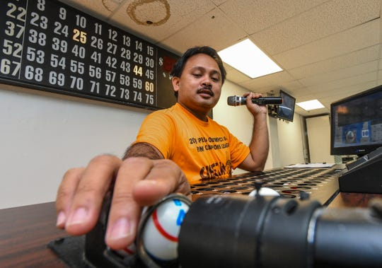 Jon Cortez prepares to call the next number in an early-bird mini bingo game at the Plumeria Bingo Hall in this Feb. 1 file photo.