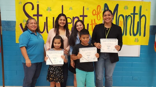 Guahan Academy Charter School's December Student of the Month awardees on Jan. 17. Pictured in the front row: Lauren Damian, Ignacio Sahafon and Kimora-Lynne Kawamoto (not shown). Pictured from left (back row): Mary Mafnas, Michelle Calvo, Camarin Sablan and Natasha Aldridge.