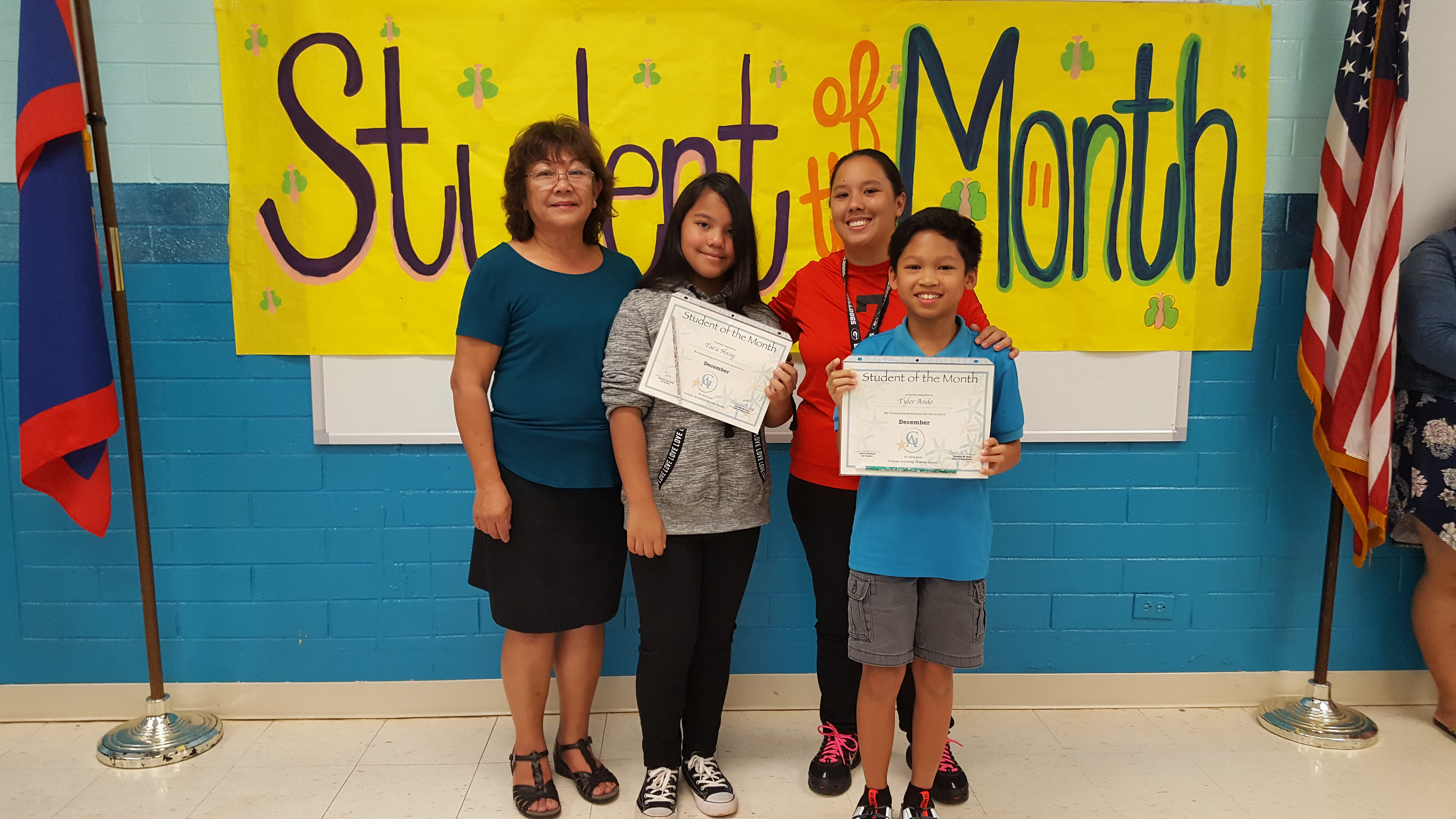 The Guahan Academy Charter School honored its December Student of the Month awardees on Jan. 17. Pictured in the front row: Tyler Ando. Back row: Teresita Cruz, Dean of High School Guahan Academy Charter School, Tae'a Hocog and Laura Taisacan.