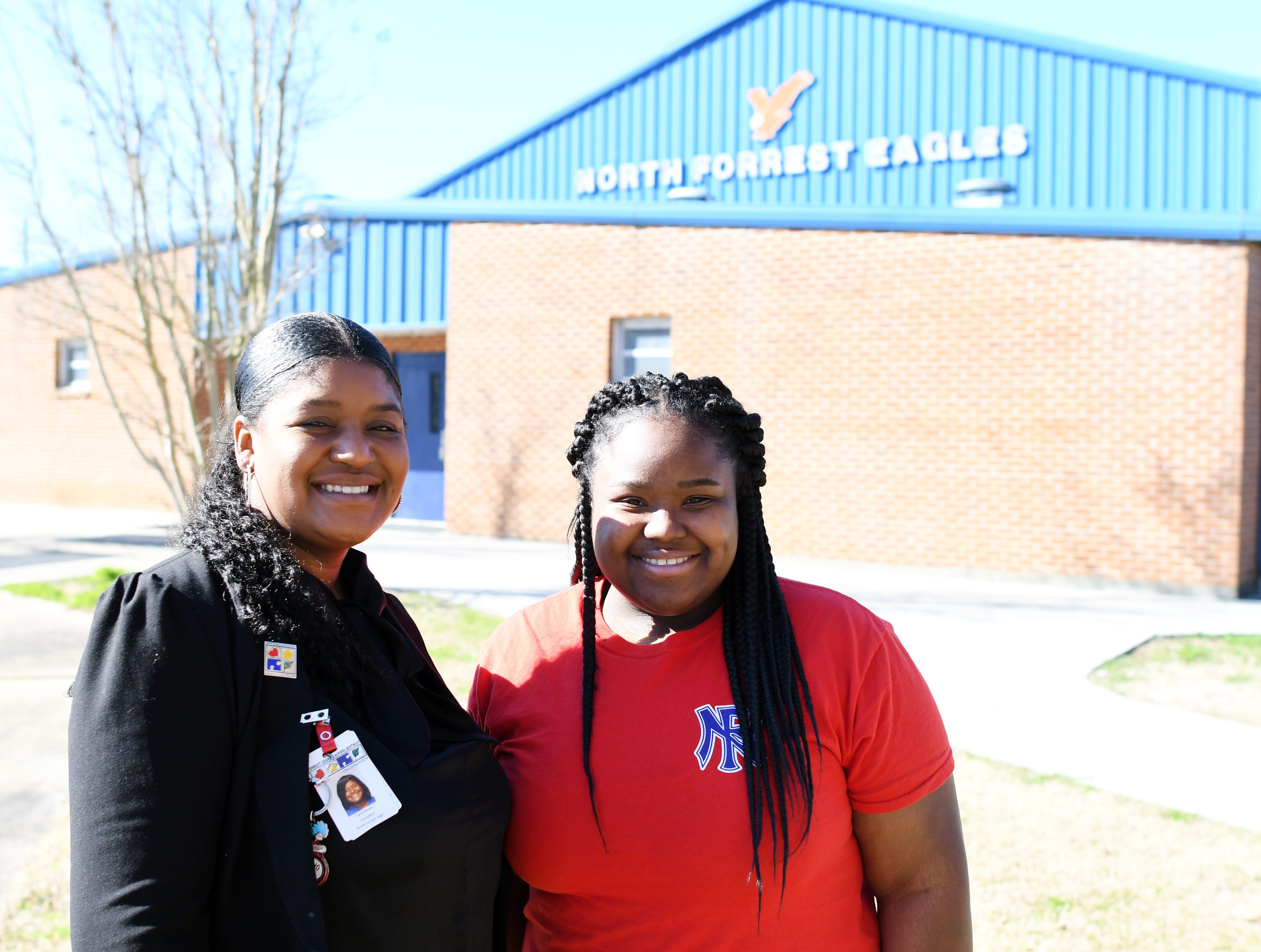 Senior Kamery Earl, right, stands with North Forrest High School counselor Carla Rawls. Rawls helps seniors throughout their year as they prepare for the future.