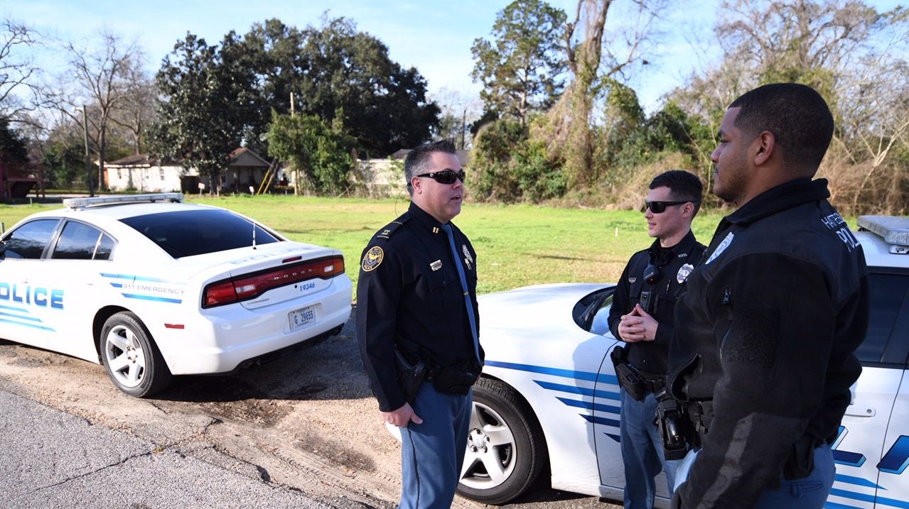 Hattiesburg Police Department Capt. Michael Fleming, left, checks in with Officers Christopher McDonald and Joshua Truss, along Dabbs Street. Both officers are assigned to the department's Quality of Life initiative, which involves community policing in three areas of the city, including the Dabbs Street neighborhood.