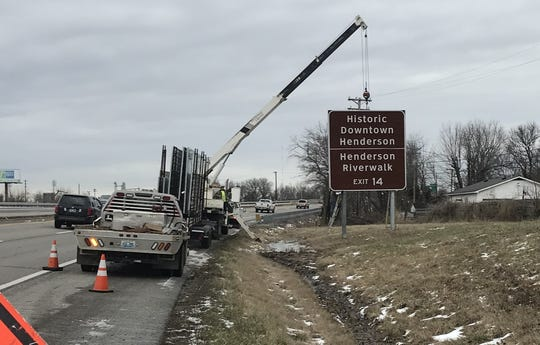 Crews erect new signs on U.S. 41 pointing the way toward Henderson's historic downtown via Second Street/Zion Road.