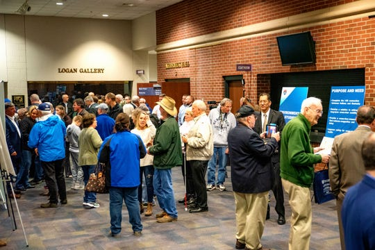 Residents, local officials and others talk to officials and view explanatory materials at a recent I-69 informational event and hearing at Henderson Community College.
