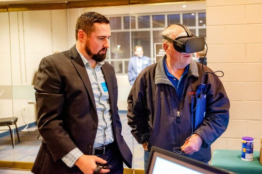 Attendees got to try out a virtual reality view of the proposed I-69 bridge crossing route during recent hearings in Henderson and Evansville.