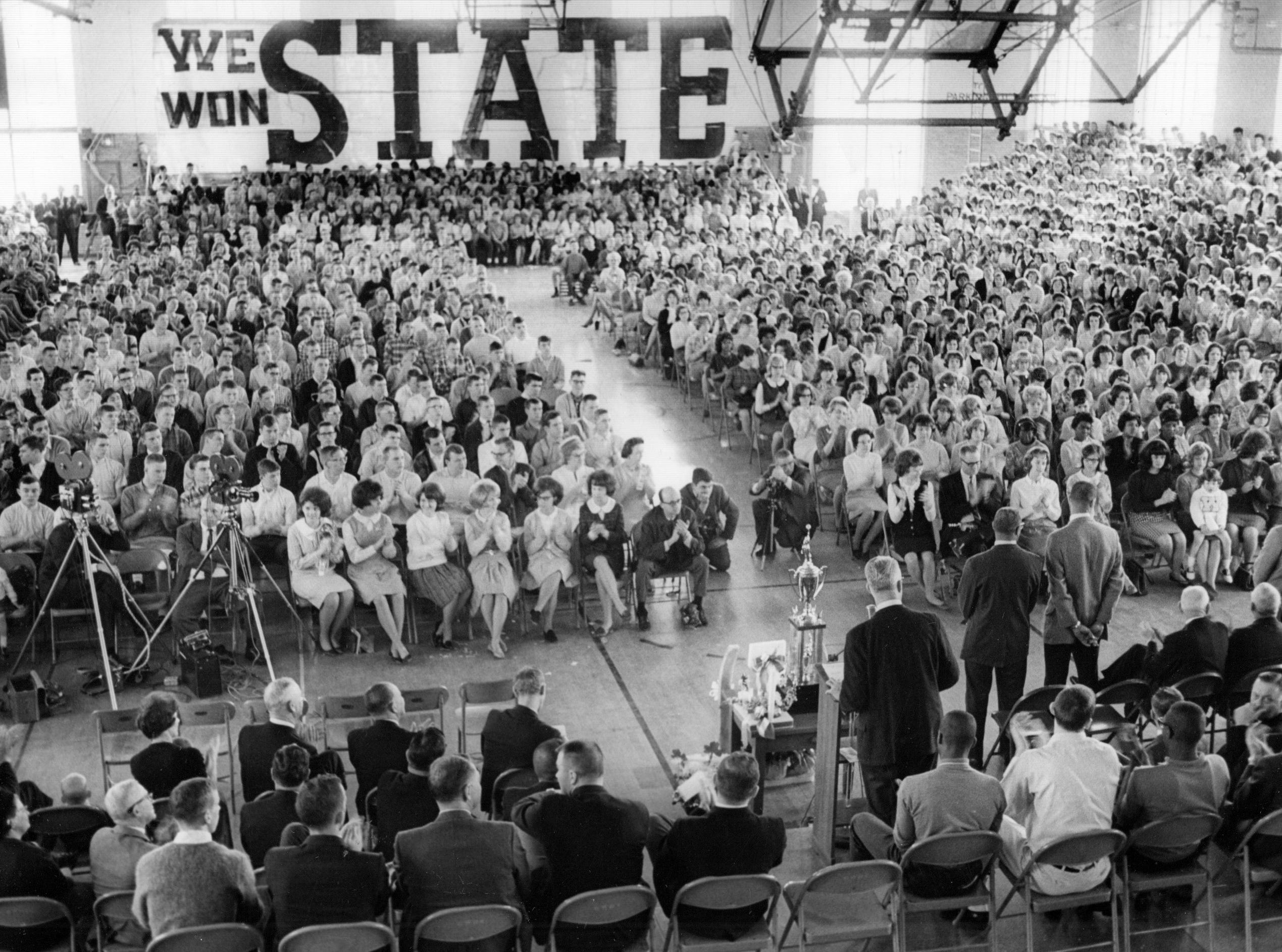 Washington celebrated its newly acquired state high school basketball championship in grand style at the school gymnasium in 1965.
