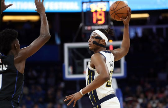 Jan 31, 2019; Orlando, FL, USA;Indiana Pacers center Myles Turner (33) drives to the basket as Orlando Magic forward Jonathan Isaac (1) defends  during the first quarter at Amway Center.