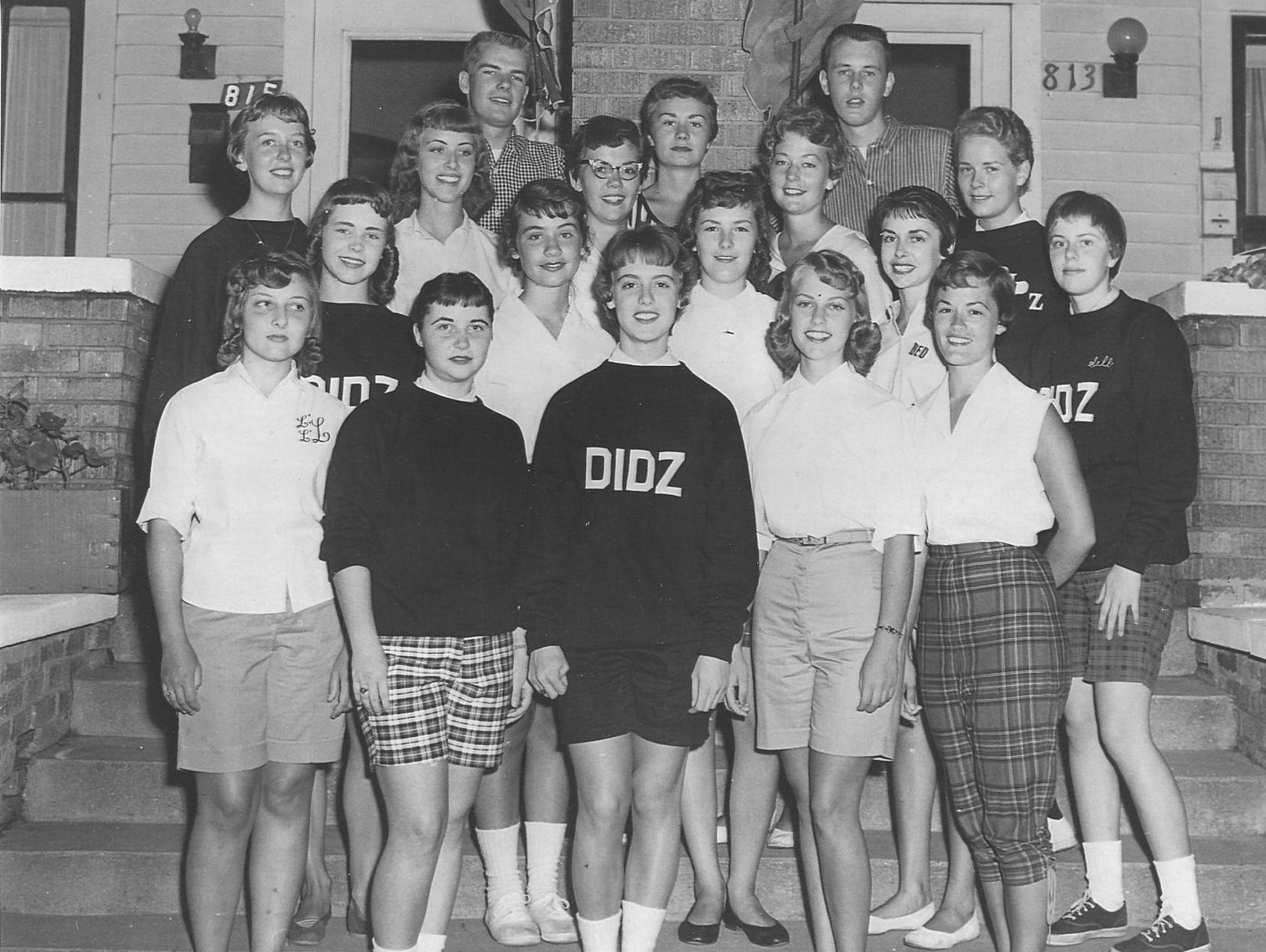 zMembers of the Darling, Idolized Dolls Club (DIDZ) Club, all 1959 graduates of Thomas Carr Howe High School in Indianapolis are (from left, back row)  Sue Staton, Denny Fulk, Natalie Lisby, Judy Sparks, Glenda Nicholas, Susan Glore, Dave Truelock,  Nancy Sharp, (second row) Mary Jo Pride, Diane Farmer, Joyce Stevens, Joyce Godwin, Diane Dobbs, Sally Ouweneel, (front row) Linda Reynolds, Judy Coe, Lana Zeyen, Nancy Cole, Carolyn Knecht.