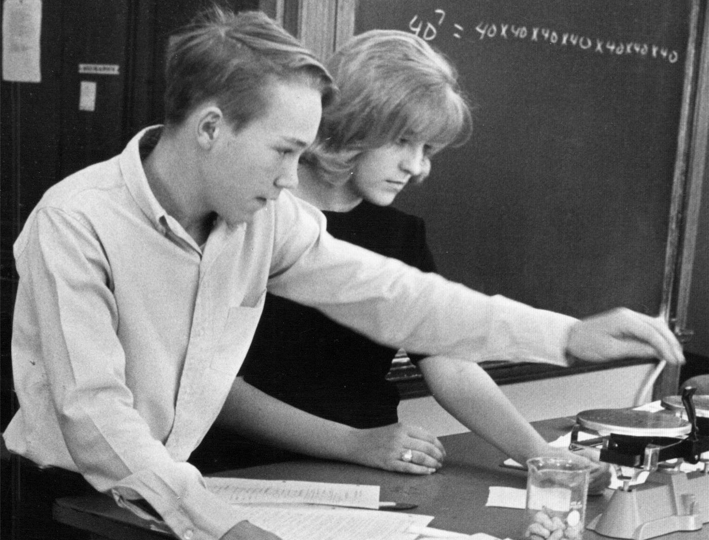 Larry Williams and Linda Holman work to determine the mass of a peanut in 1968. Wood High School was the only school in Indiana and one of 27 in the country to try the quantitative physical science program developed by Duke University.
