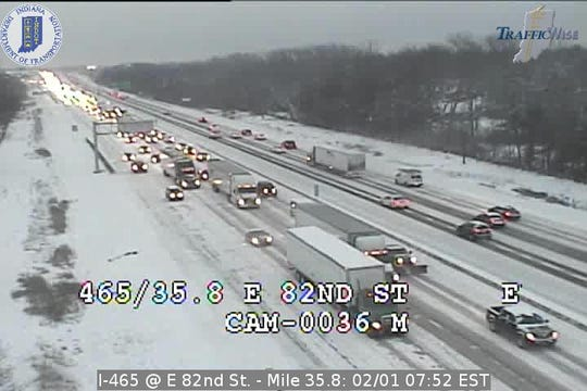 Indianapolis roads are snow-covered and slick Friday morning, including at I-465 and E. 82nd Street.