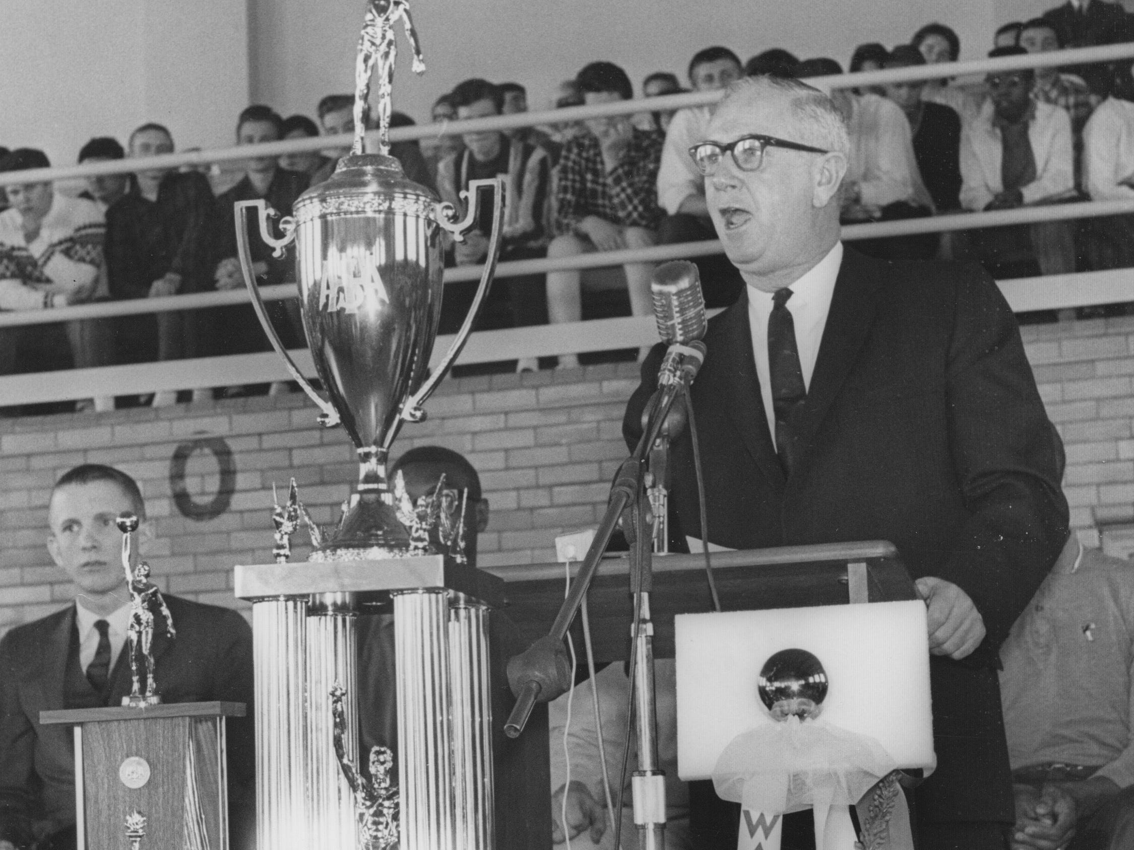 Indianapolis Mayor John Barton addressed students and faculty at Washington High School as it celebrated their 1965 state basketball championship. Barton presented the key to the city to coach Jerry Oliver.