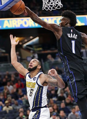 Orlando Magic's Jonathan Isaac (1) blocks a shot-attempt by Indiana Pacers' Cory Joseph (6) during the first half of an NBA basketball game, Thursday, Jan. 31, 2019, in Orlando, Fla.