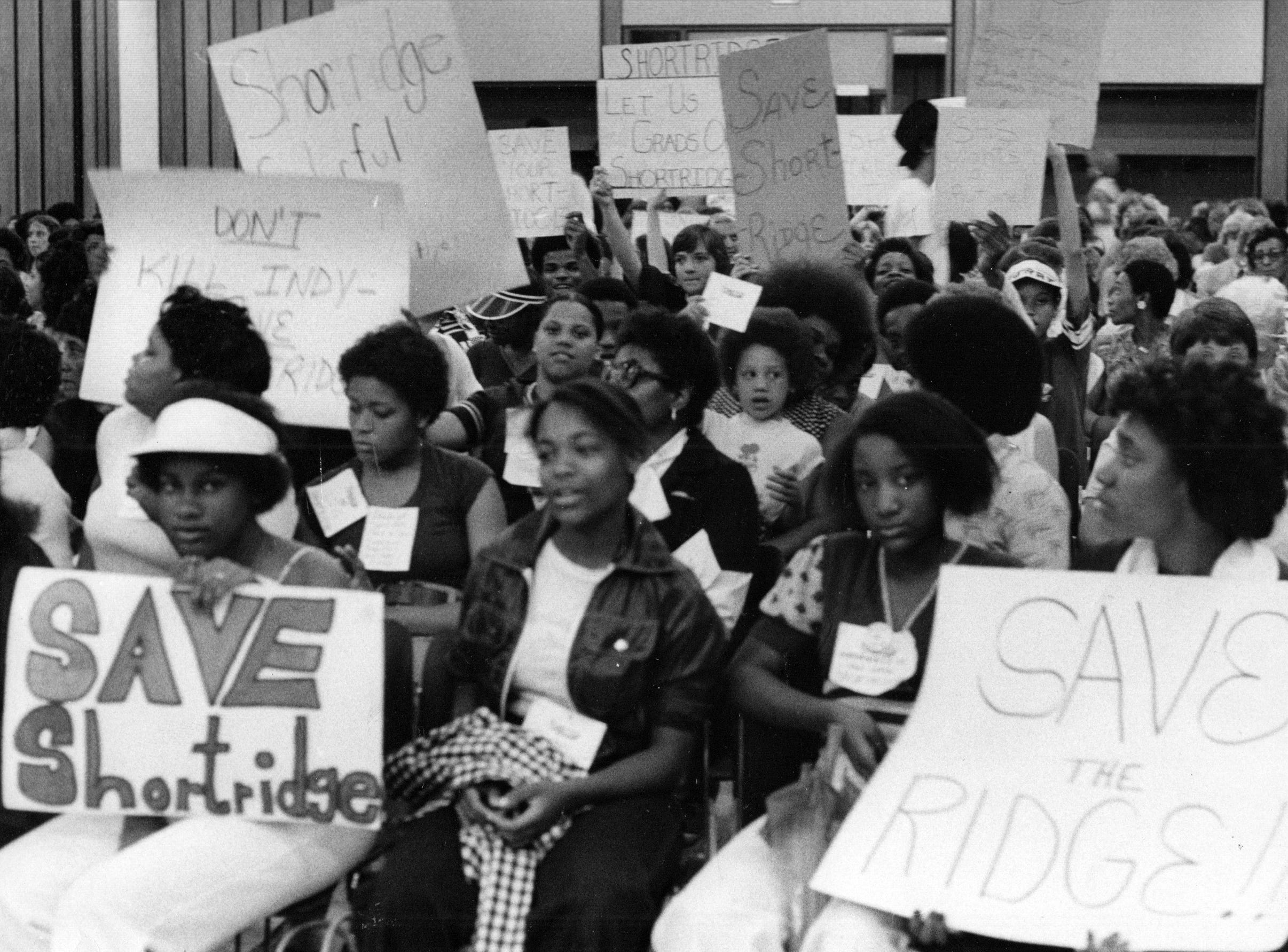 Shortridge students attend a school board meeting in 1977. The possible closing of Shortridge and Harry Wood High Schools set off an emotional demonstration. Shortridge remained open for a few more years, while Wood High School would close in 1978.