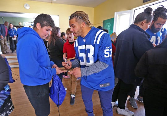 Former Colts player Edwin Jackson, right,  was always big into community service.